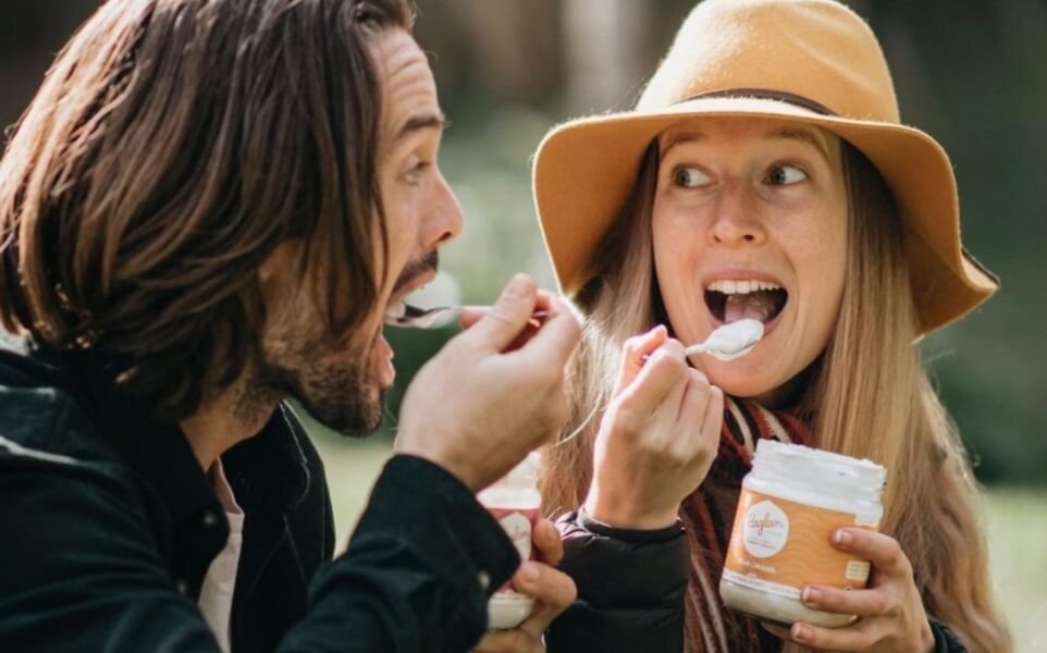 Photograph of Seb and Tesh eating Raglan Food Co coconut yoghurt